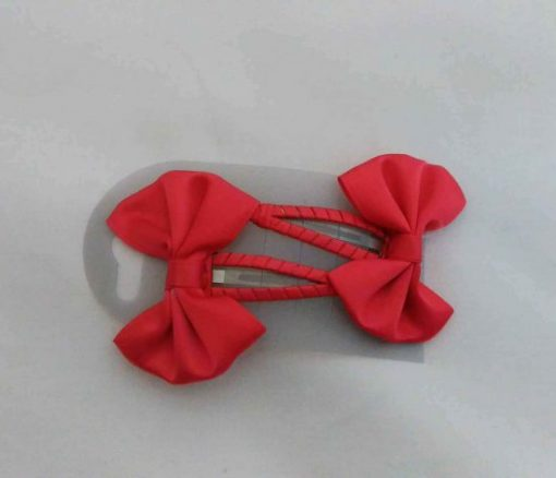 Barrette noeud rouge